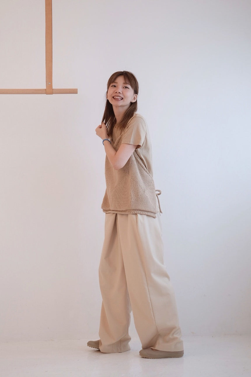 CURVED-LEG PLEATED TROUSERS