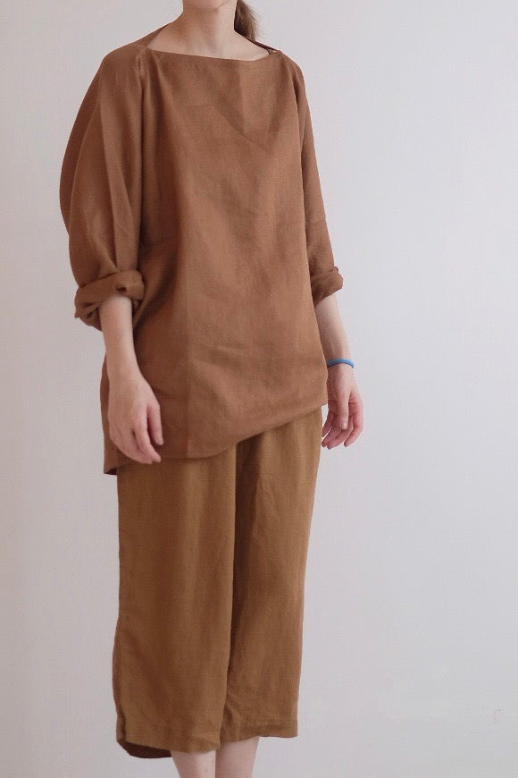 LINEN CROPPED TROUSERS IN DIRTY ORANGE