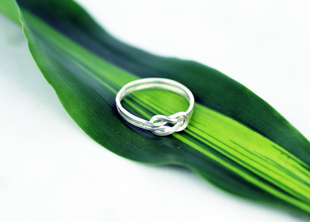 Artisan crafted Evighet ring by M of Copenhagen showcased on a leaf