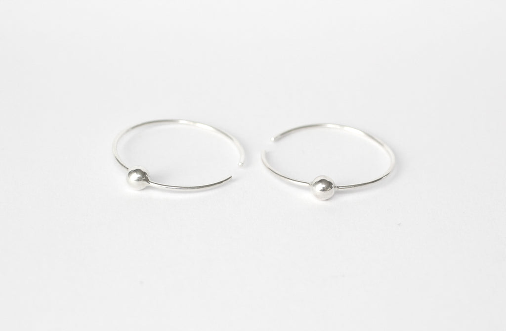 Carmen earrings made from recycled 925 silver from M of Copenhagen on a flat lay white background