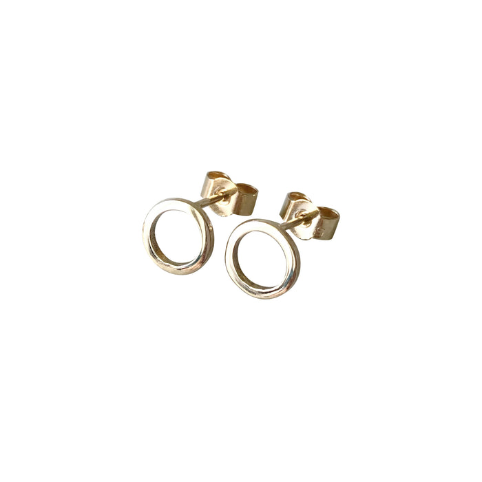Circle gold earrings by M of Copenhagen on white background