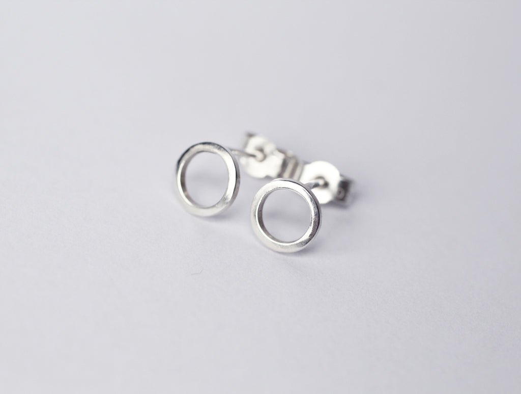 Continuum earrings by M of Copenhagen made from recycled silver on white background
