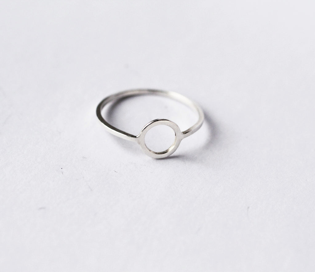 Continuum ring by M of Copenhagen made from recycled 925 silver on a flatlay