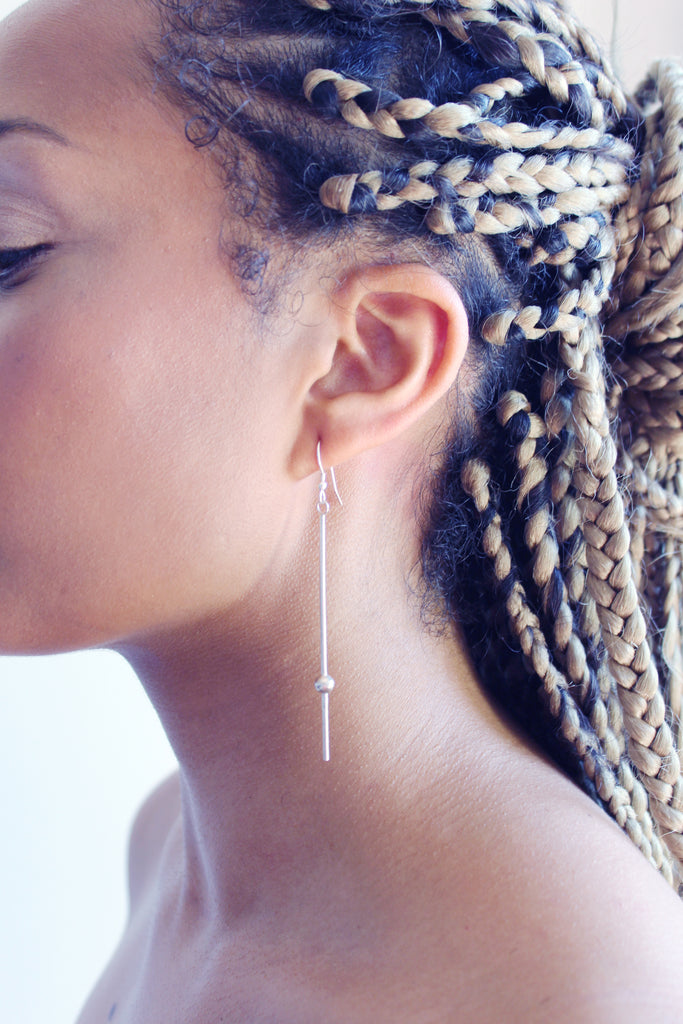 Dew earrings by M of Copenhagen made from recycled silver on model