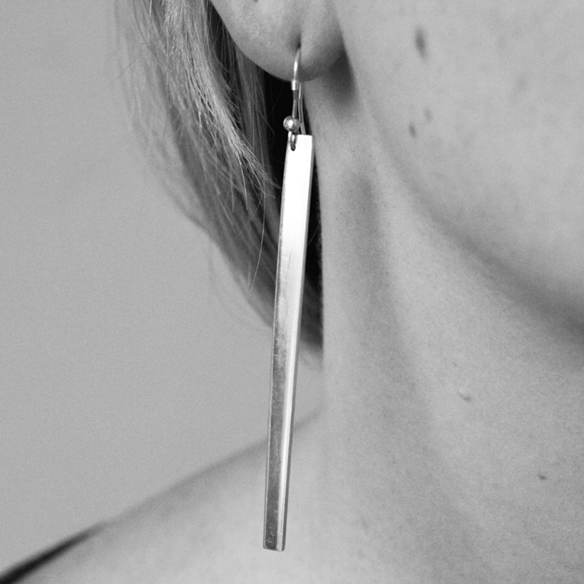 Divided earrings by M of Copenhagen artisan jewellery shown on model