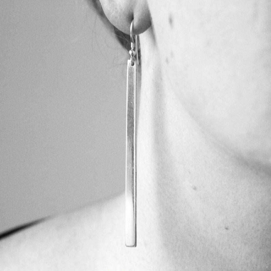 Divided earrings by M of Copenhagen showcased on model