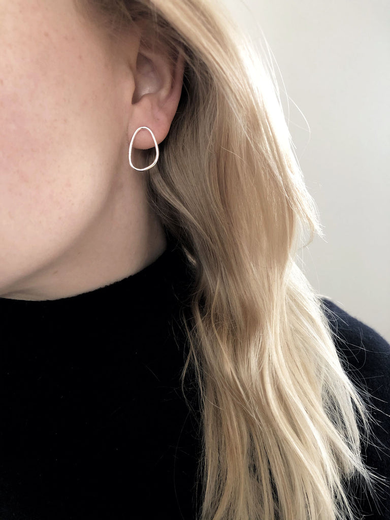 Elena Mini oval silver earrings on model by M of Copenhagen