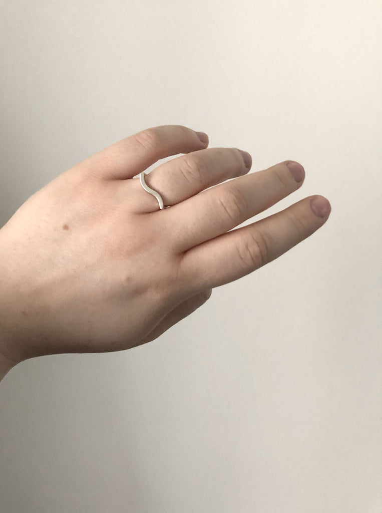 Ever-ring-in-recycled-silver-by-eco-jeweller-M-of-Copenhagen-shown-on-models-hand