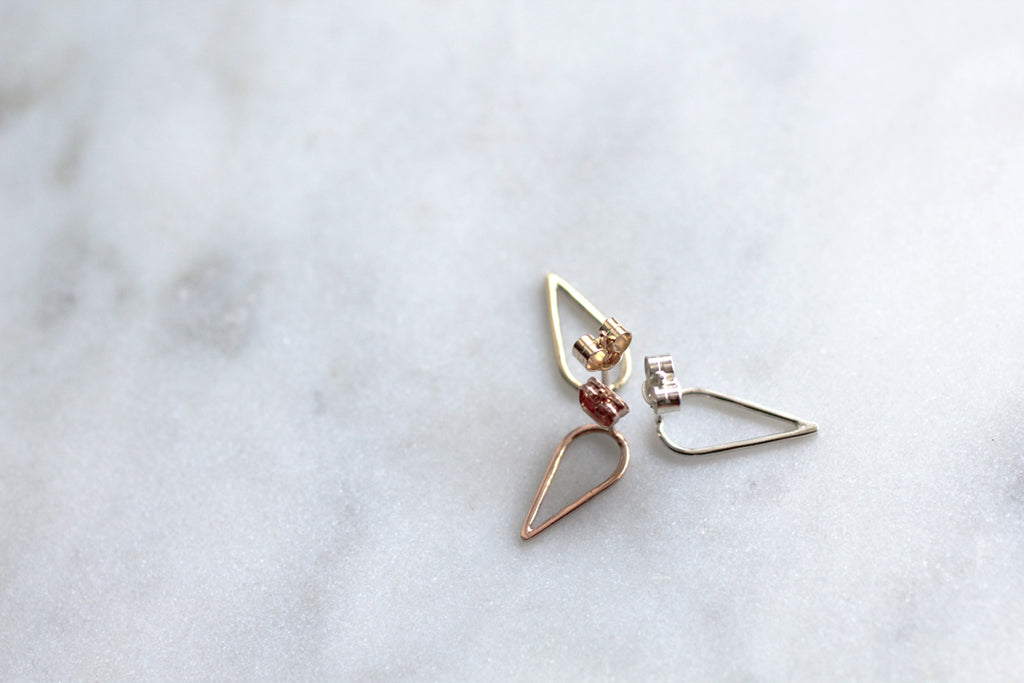 Filippa Arrow by eco jeweller M of Copenhagen in gold red gold and silver