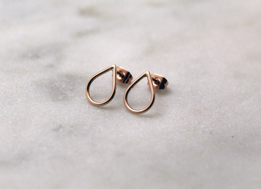 Filippa Minis in 9 ct red gold by M of Copenhagen laid out on marble