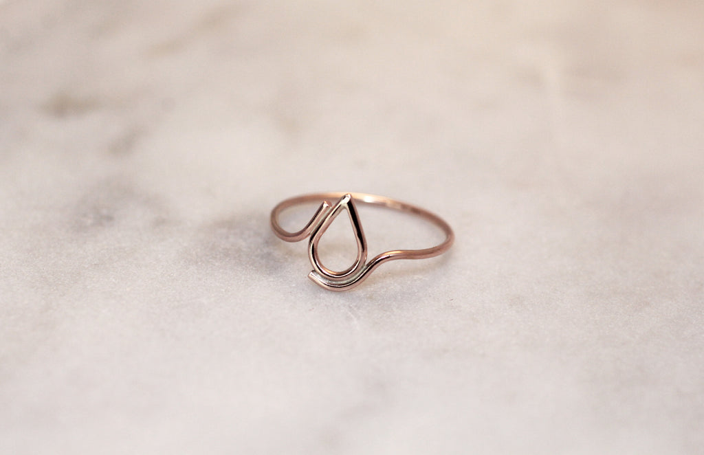 Filippa Ring 9 ct red gold by M of Copenhagen on marble