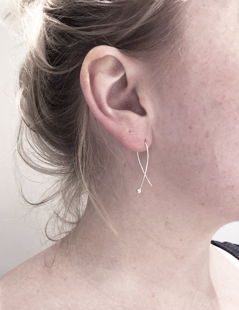 Gabrielle earrings in recycled silver by m of Copenhagen eco jeweller on model