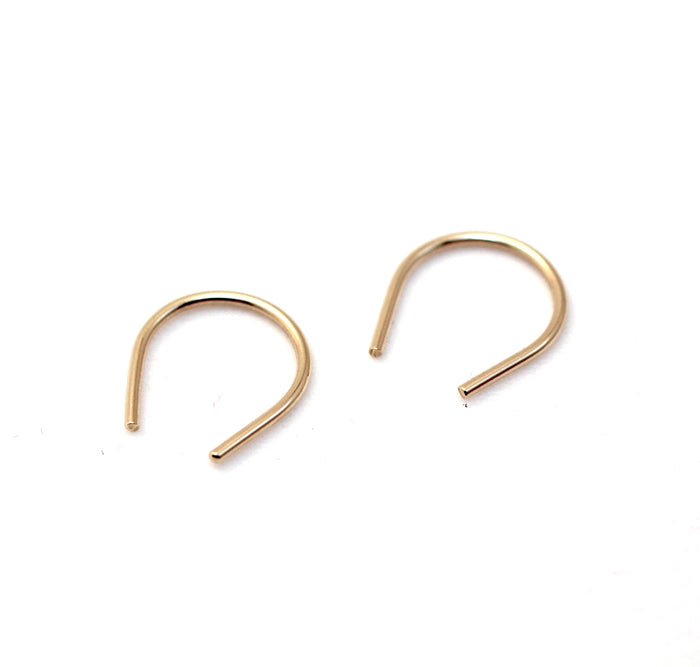 Hook mini earrings by M of Copenhagen on white background flatlay