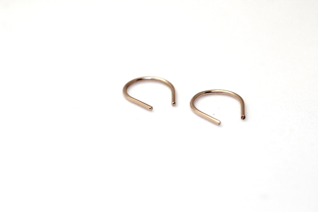 Hook minis by M of Copenhagen from 9 ct red gold on white background