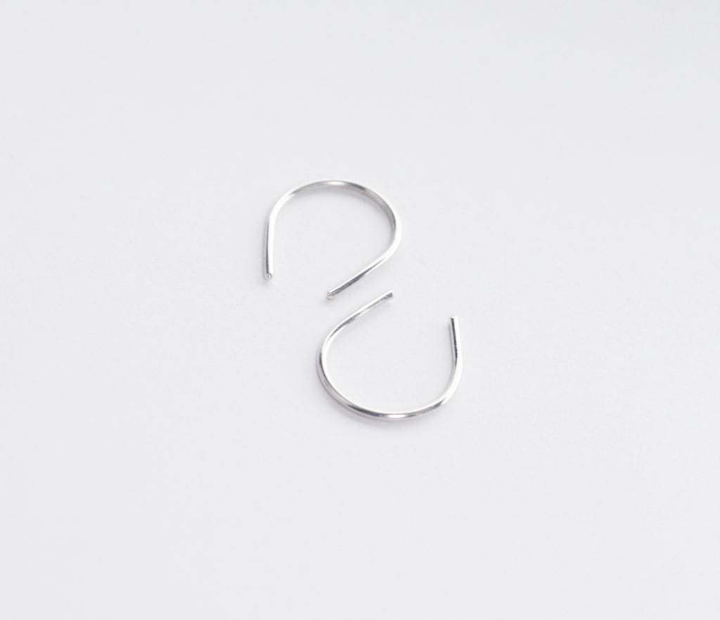 Hook recycled sterling silver earrings by eco jeweller M of Copenhagen flatlay white background