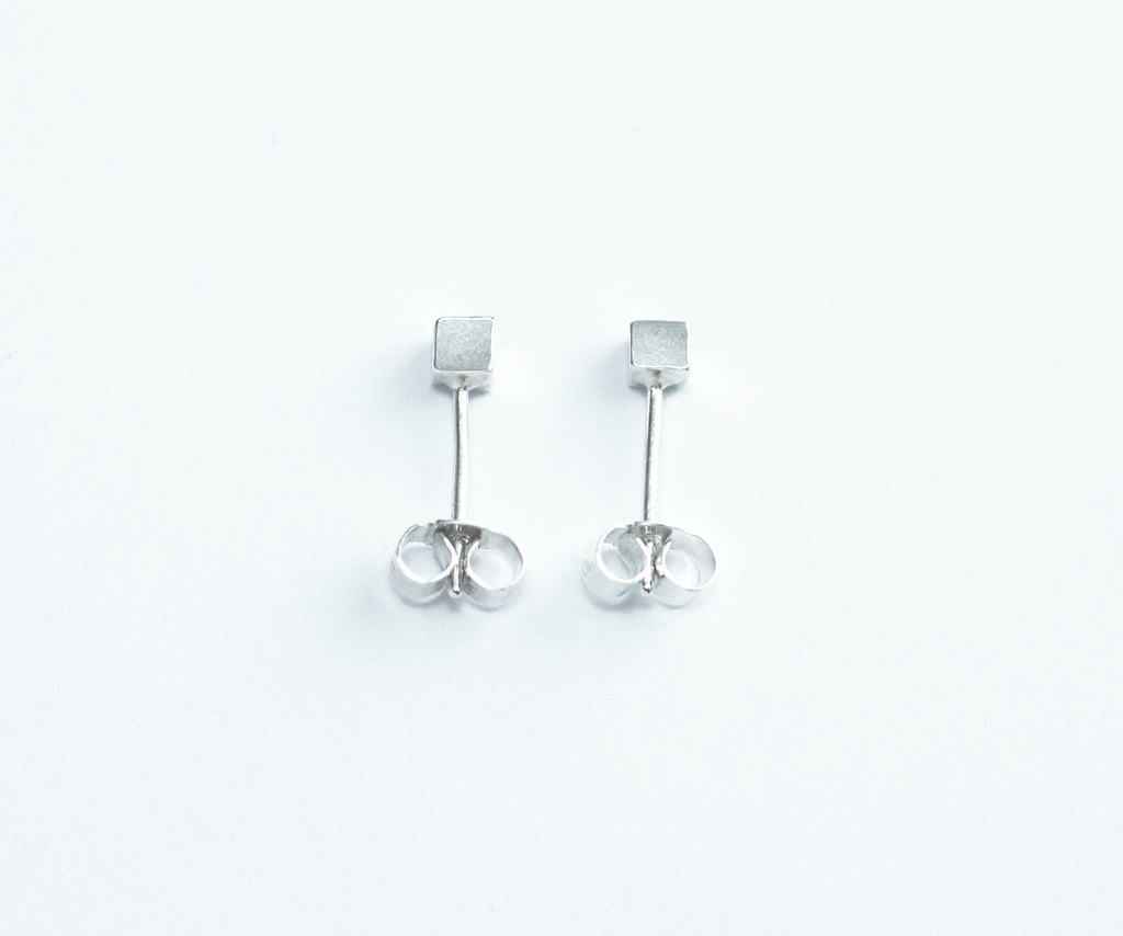 Kloss earrings by M of Copenhagen flatlay on white background