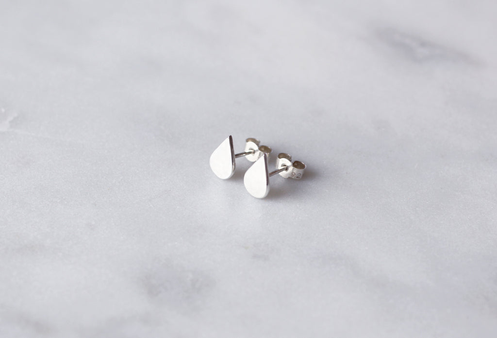 Laguna earrings by M of Copenhagen shown on marble surface