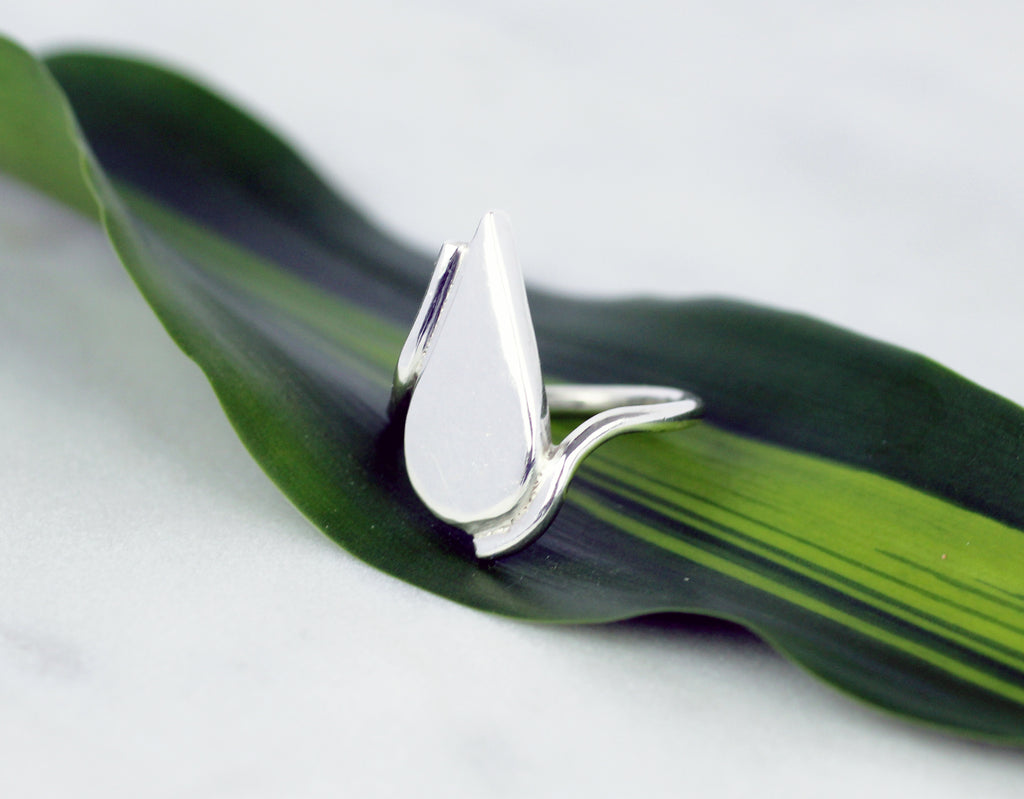 Laguna ring by M of Copenhagen shown from the side posed on leaf
