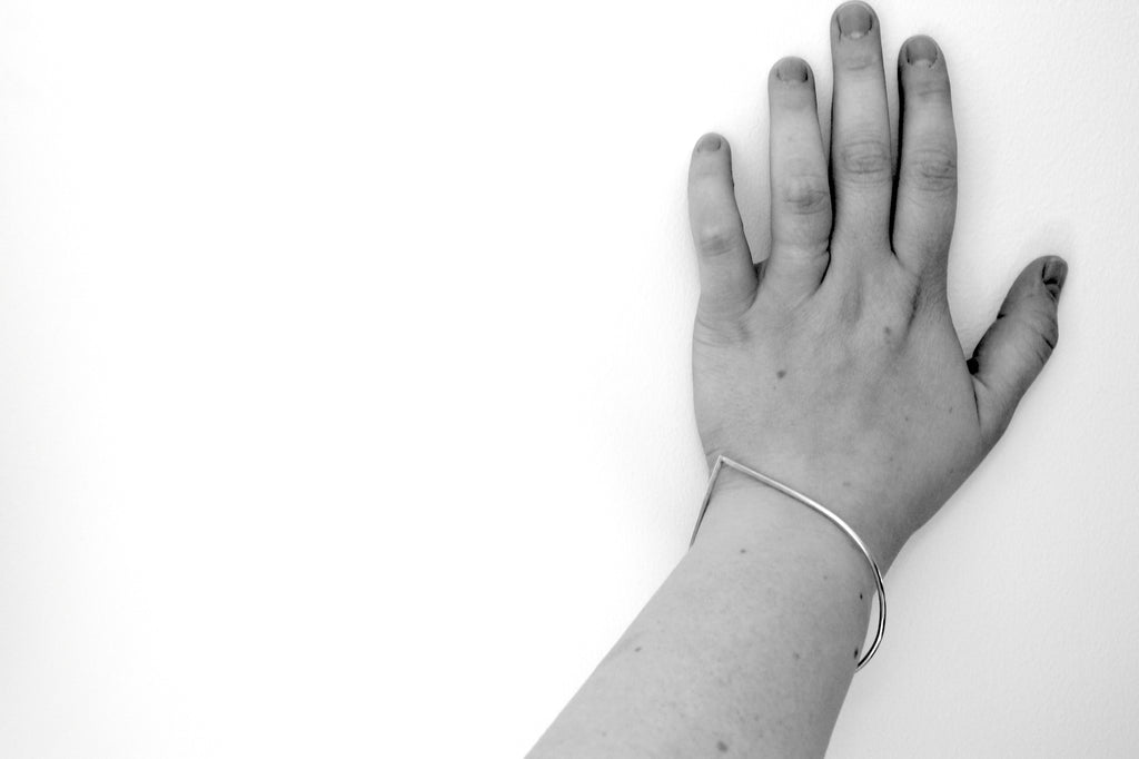 Portofino bangle by M of Copenhagen in silver, seen on hand