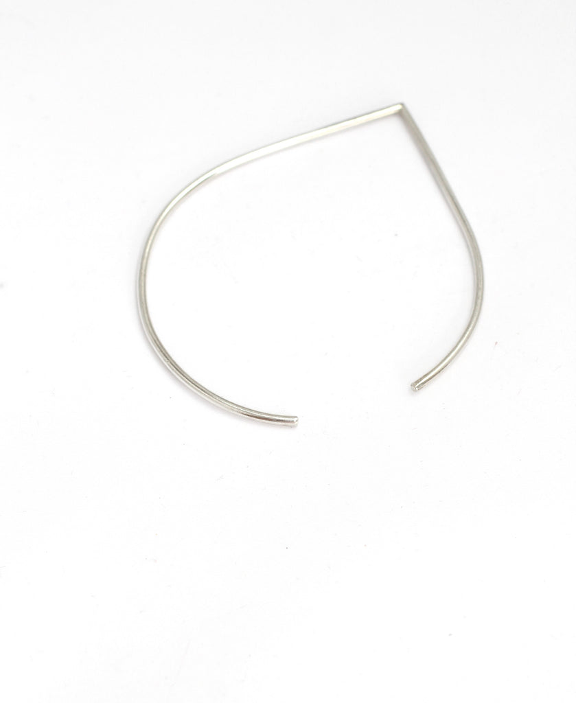 Portofino bangle by M of Copenhagen made with recycled silver on white background