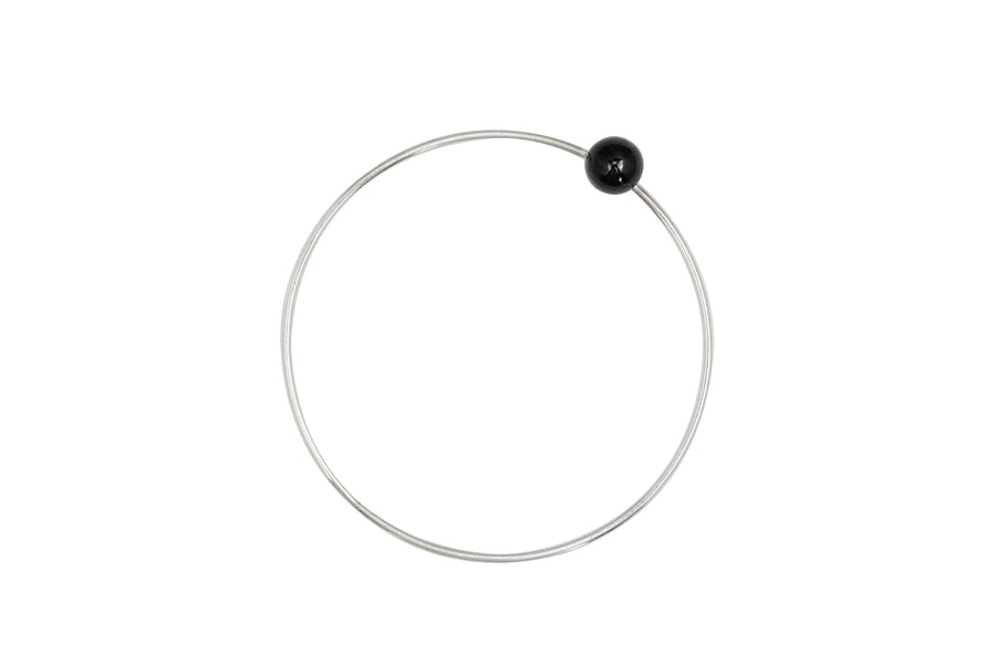 Positano bangle by M of Copenhagen made with recycled silver and a natural obsidian bead
