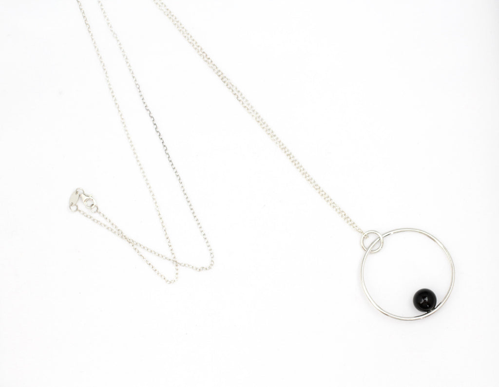 Positano necklace by M of Copenhagen made with recycled silver and onyx in flat lay