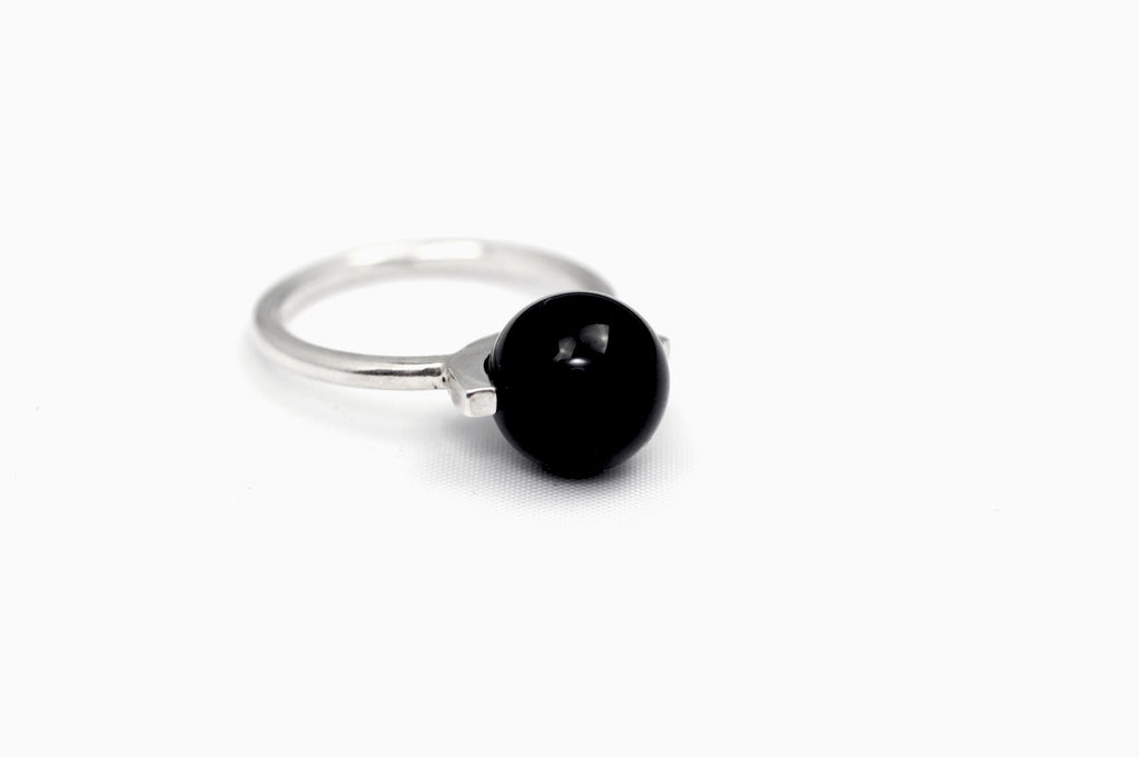 Positano ring by M of Copenhagen made with recycled silver and a natural onyx bead frontview