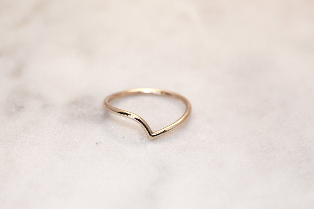 Recycled gold ring by M of Copenhagen laid out on marble