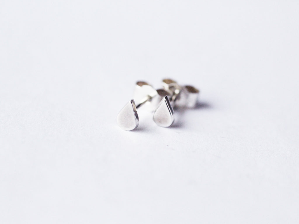 Recycled silver earrings Laguna Mini by M of Copenhagen laying on white background
