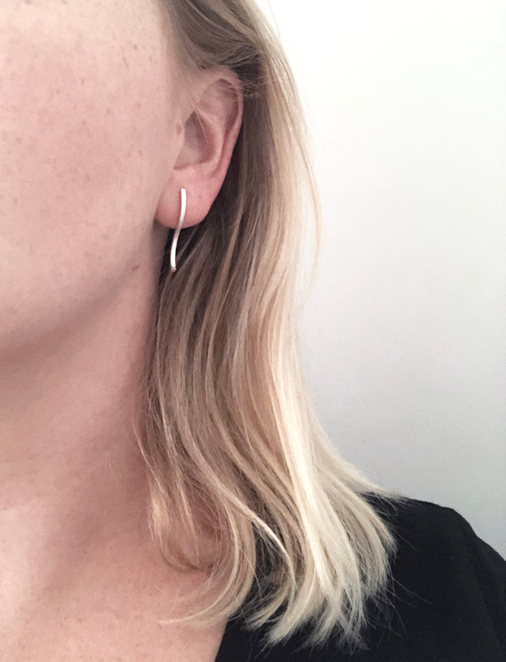 S Shaped silver earrings by M of Copenhagen on model up close