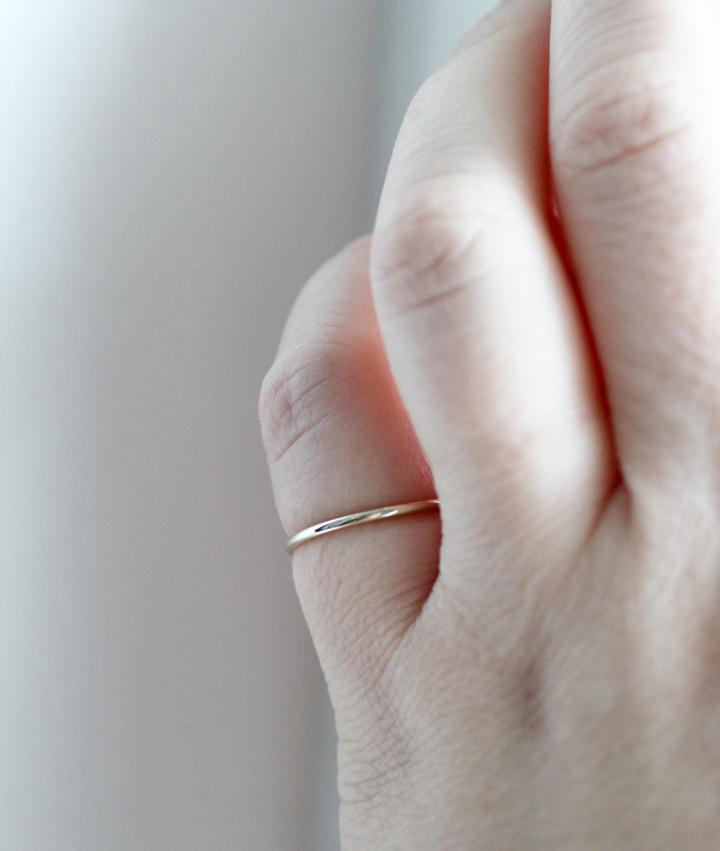Stella stacking ring in silver by M of Copenhagen on models hand