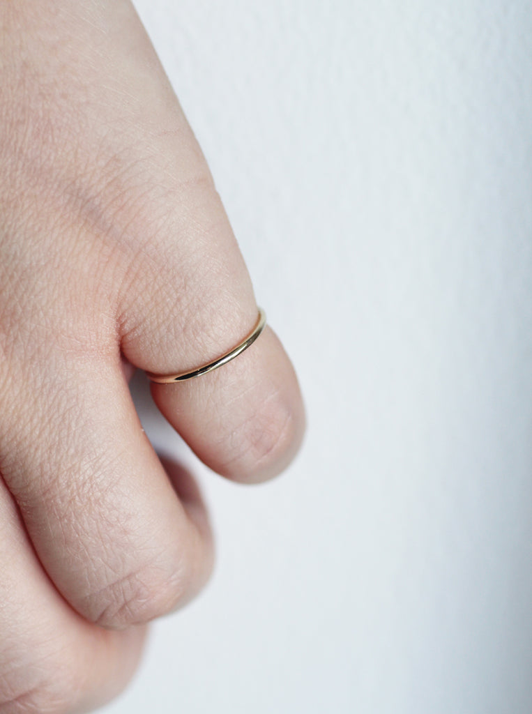 Stella stacking ring in gold by M of copenhagen on models hand