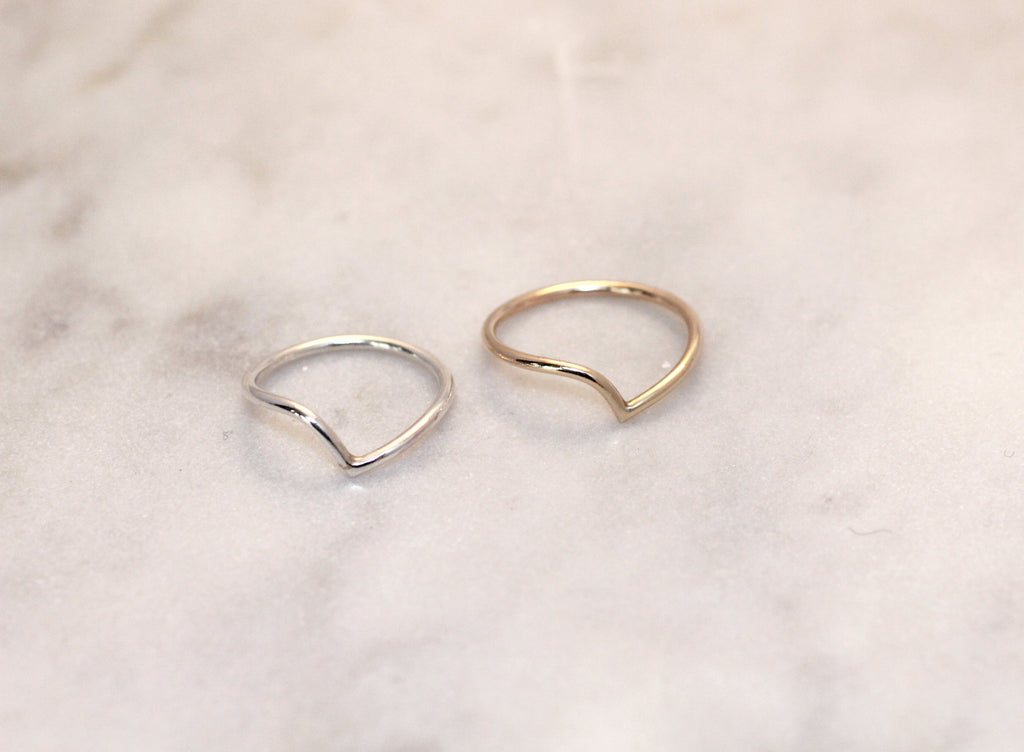 Thy rings by M of Copenhagen in flat lay on marble