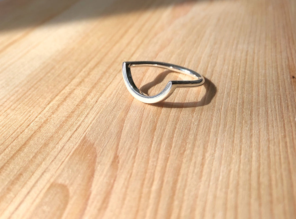 Uno-unisex-curve-ring-in-recycled-silver-by-M-of-Copenhagen.