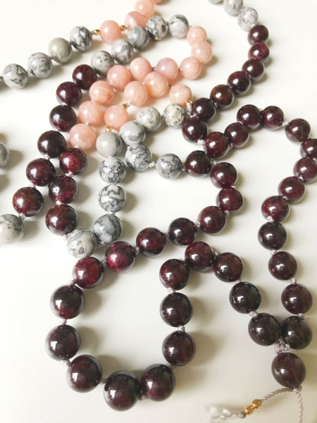 Open and Grounded Mala