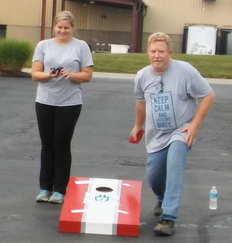 Ag Lab Manager Marty Snodgrass and Veronica Kwasny compete in a friendly game of cornhole