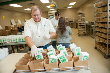 A&L employees sorting items