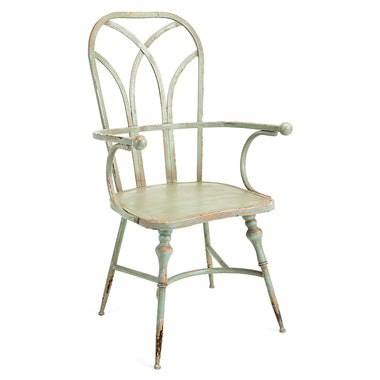 Sage green metal chair.  It is beautiful and ornate with a farmhouse edge to it.  I think it could go with just about anything.  Of course, it is my favorite color and chair. It is an arm chair and a group would look perfect sitting around a round shaped wooden farm table.