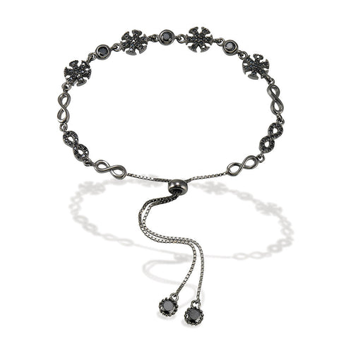 "7.5"" adjustable length black rhodium bracelet with alternating white CZ and silver infinity signs with 4 CZ stars and bezel set CZs with two bezel CZ ends"