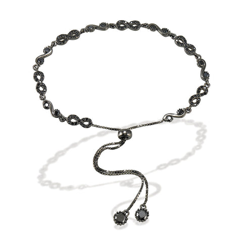 "7.5"" adjustable length black rhodium bracelet with silver infinity signs with 3 bezel set CZs in between and bezel set CZs with two bezel CZ ends"