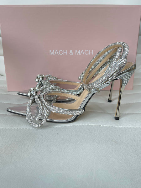 Mach and Mach 110 PVC Clear Silver Double Bow Crystal Embellished Pumps