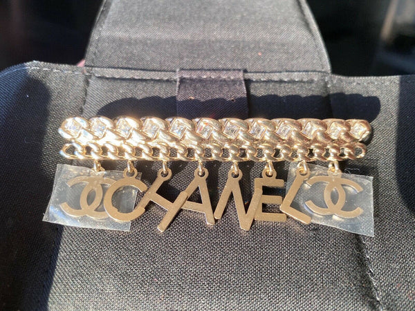 "CHANEL GOLD ""CHA""NEL"" CC LOGO WHITE CRYSTALS CHARMS BROOCH PIN"
