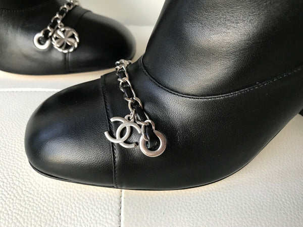 CHANEL BLACK LAMBSKIN LEATHER SILVER CHAIN CC LOGO CAMELLIA SHORT BOOTS