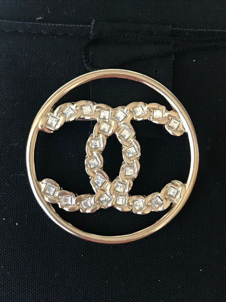 CHANEL 2019 GOLDEN TONE CC LOGO WHITE CRYSTALS ROUND BROOCH PIN CHARM