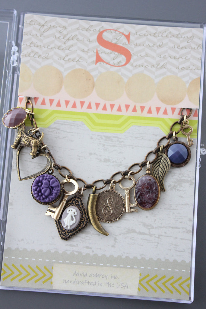 CMB9 VINTAGE PURPLE GLASS CHARM BRACELET
