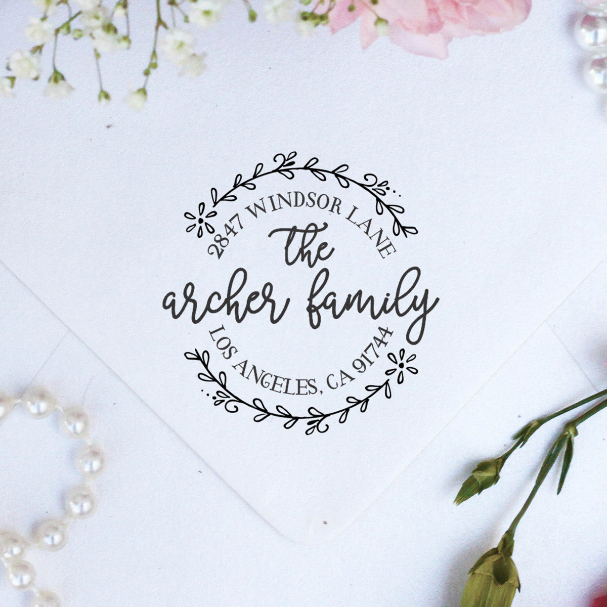 return address stamp archer family stamp out