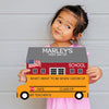 School bus shaped first day of school sign