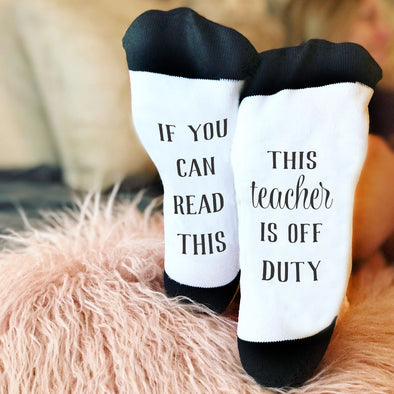 "Funny Socks, Bottom of Sock Sayings, ""If you can read this, This Teacher if Off Duty"""