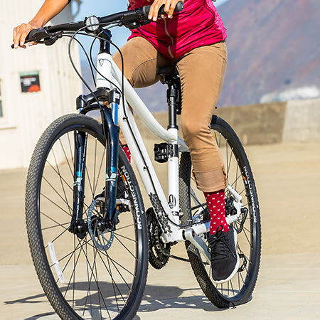 Bike rider wearing In-Stitches Brick Red Socks by Lily Trotters