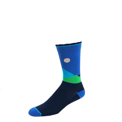 Designer performance compression crew sock featuring moonlit mountaintops design in shades of blue